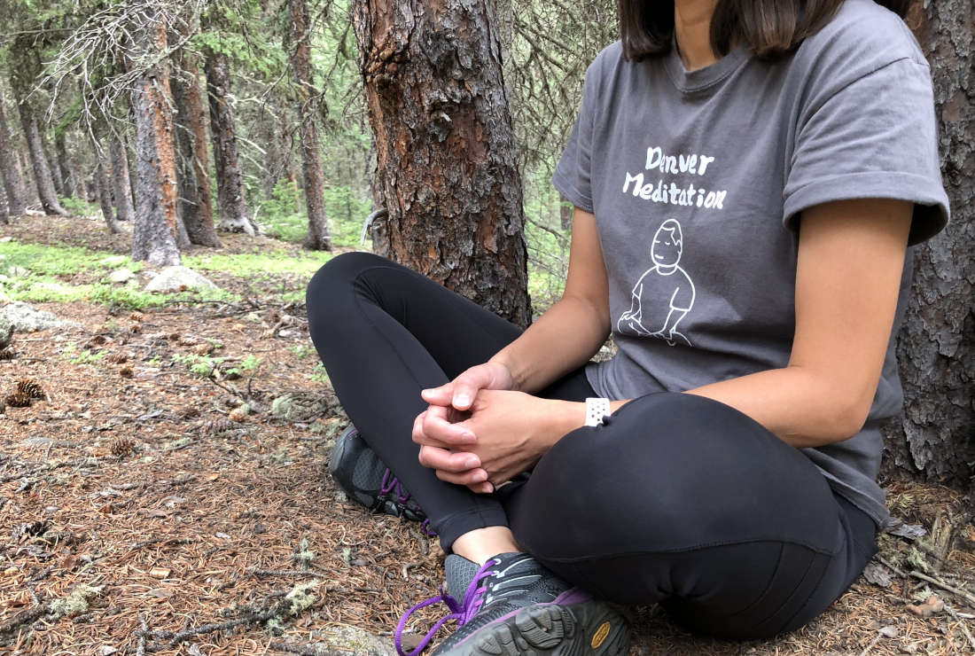 woman in meditation in forest